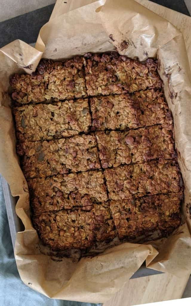 Protein vegan flapjacks in baking tin, cut into slices.